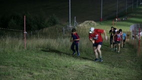 The participants of the race Night 10 overcome the uphill stock footage