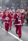 Participants racing Santa Clauses-2 Royalty Free Stock Photo