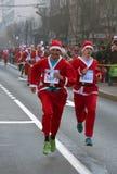 Participants racing Santa Clauses Stock Image