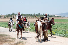 Participants in the reconstruction of Horns of Hattin battle in 1187 left the camp on horseback and go to the battle site near Tib Royalty Free Stock Photo