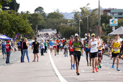 Participants Running in the 2014 Comrades Marathon Road Race Royalty Free Stock Photography