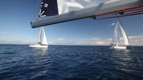 Participants in sailing regatta 11th Ellada Spring 2014 among Greek island group in the Aegean Sea stock video footage