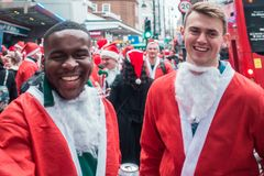 Participants of Santacon event in London stock photos