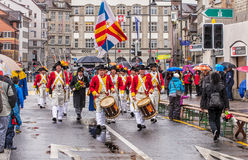 Participants of the Sechselauten parade passing along Uraniastra Royalty Free Stock Image