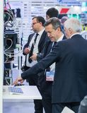 Business people at the company stand. Royalty Free Stock Photo