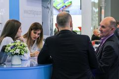 People talking at the counter. Royalty Free Stock Photos