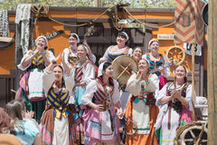 Participants wearing typical clothes, singing and dancing Royalty Free Stock Images
