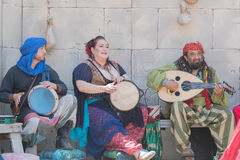 Participants wearing typical clothes, singing and playing Stock Photos