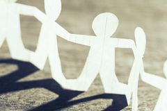 Participate in Team. Work, closeup one of human chain paper stock photography