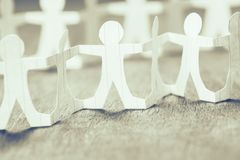 Participate in Team. Work, closeup part of human chain paper royalty free stock image