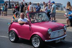 Participates take part with small car at Blackpool Pride festival. Blackpool, United Kingdom - 09.06.2018 Participates take part with small car at Blackpool Stock Photo