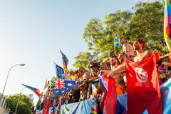 Participating dancing during the parade, moving the flags around Stock Photography