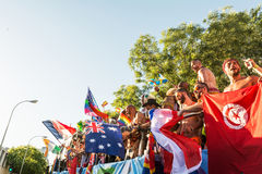 Participating dancing during the parade, moving the flags around Royalty Free Stock Photography