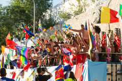 Participating dancing during the parade, moving the flags around Royalty Free Stock Images