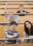 Participating students in a lecture hall Royalty Free Stock Images
