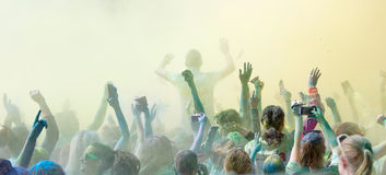 The participator in the Color Run waiving the arms in the sky Royalty Free Stock Image