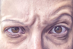 Particles on angry elder eyes Stock Image