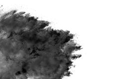 The particles of charcoal splatted on white background. Stock Photo