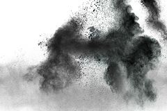 Particles of charcoal splatted on white background Stock Image
