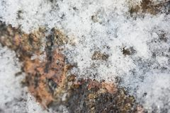 Particles of snow on a marble wall close-up, soft focus Royalty Free Stock Images