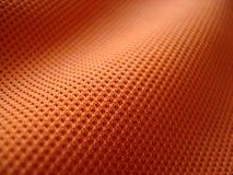 Particolare arancione del tessuto Immagine Stock