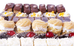 Particolare dei bigné della frutta, del cioccolato e della vaniglia Immagini Stock Libere da Diritti