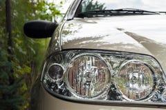 Particolare del faro dell'automobile Fotografie Stock