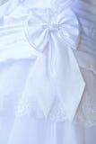 Particolare del vestito da cerimonia nuziale Immagine Stock