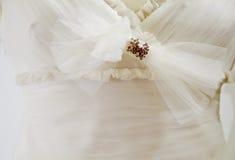 Particolare del vestito da cerimonia nuziale Fotografia Stock