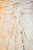 Particolare del vestito da sposa Fotografia Stock