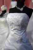 Particolare di un vestito da cerimonie nuziali Fotografie Stock
