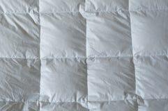 Particolare giù del comforter Fotografia Stock Libera da Diritti