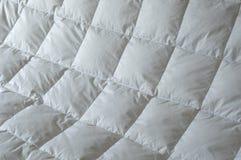 Particolare giù del comforter Fotografia Stock