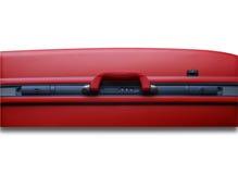 Particolare rosso della valigia Immagine Stock