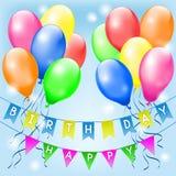 Particolored Ballone und kleine Flaggen Stockfotografie