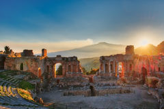 Particular of Ancient theatre of Taormina with Etna erupting vol royalty free stock images