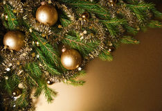 A particular of a Christmas tree with decorations. Stock Image