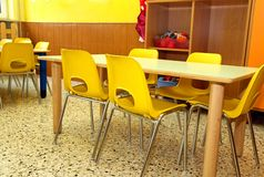 Particular of a classroom in a kindergarten with little yellow c Stock Photography