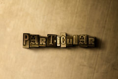 PARTICULAR - close-up of grungy vintage typeset word on metal backdrop Royalty Free Stock Photos