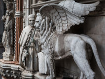 Particular of Doge's Palace Facade in Venice: Marble Winged Lion Stock Images