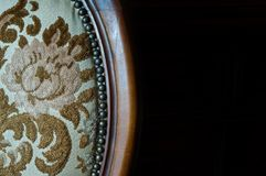 Old upholstered wood chair. Particular of an old upholstered wood chair to restore Royalty Free Stock Photo