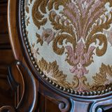 Old upholstered wood chair. Particular of an old upholstered wood chair to restore Stock Images