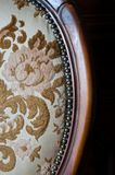Old upholstered wood chair. Particular of an old upholstered wood chair to restore Stock Image