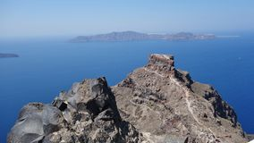 Rocks on the sea in Santorini, Greece stock photo
