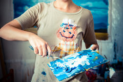 Particular of woman painter hand painting Royalty Free Stock Photo