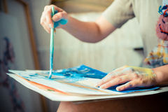 Particular of woman painter hand painting Royalty Free Stock Image
