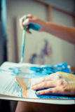 Particular of woman painter hand painting Stock Photo