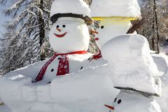 Particularly beautiful snowmens in a skiing region stock images