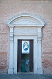 Particularly the entry door of the church of santarcangelo roma Stock Images