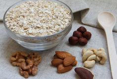 Particularly gentle oatmeal with nuts. On natural fabric Stock Images